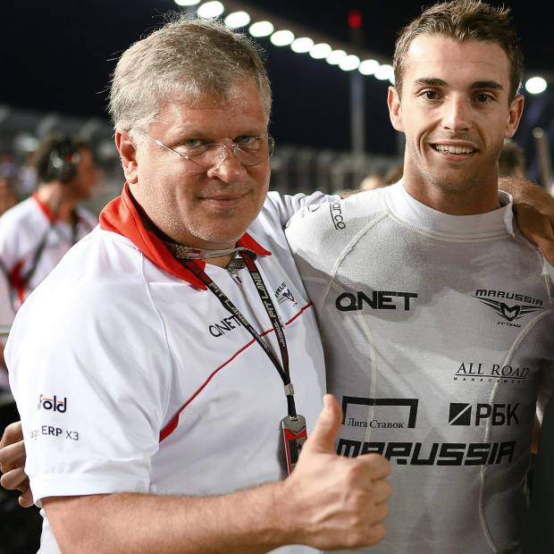 Andrey Cheglakov (left) with Marussia driver Jules Bianchi at the Singapore Grand Prix, September 2013