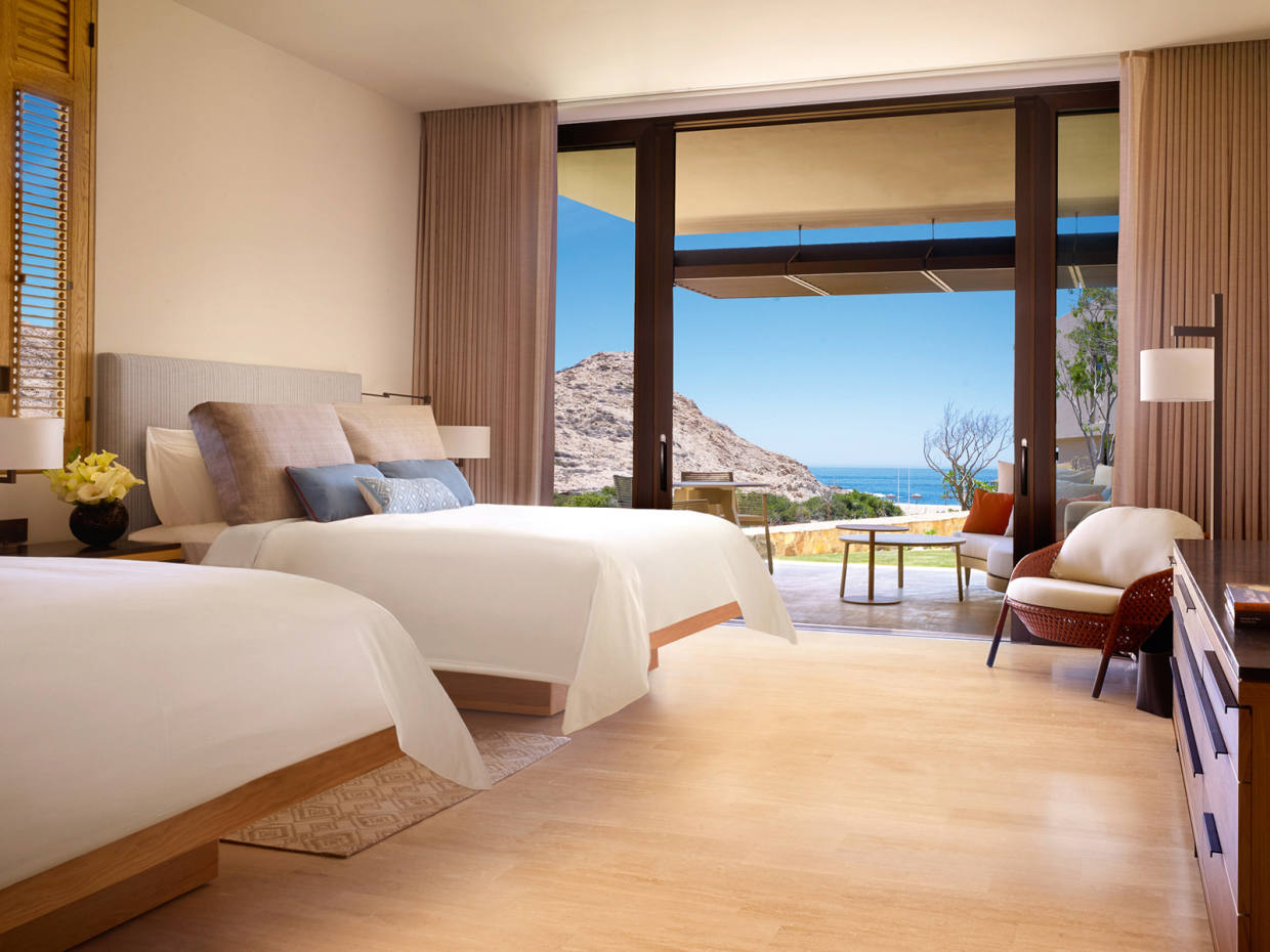 A deluxe room at Montage Los Cabos in Baja California, with sweeping views over Santa Maria Bay