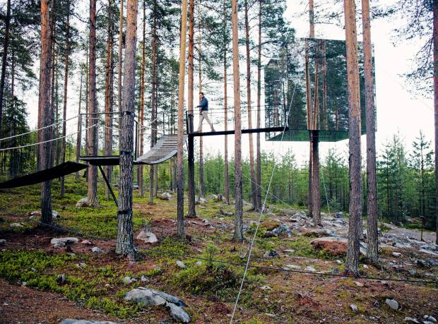 The camouflaged exterior of Treehotel's Mirrorcube suite