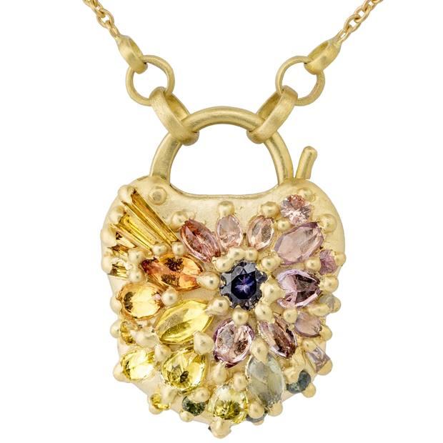 PollyWalesd'Ornanopadlockpendant with multicoloured sapphiresin gold, £8,200