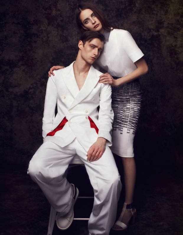 He wears Alexander McQueen cotton jacket, £1,295, cotton trousers, £540, and leather trainers, £360. She wears Boss cotton and organza shirt, £350, silk and organza skirt. £600, and leather sandals, £1,500
