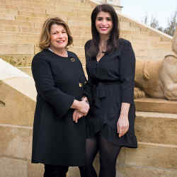 Château Margaux's owner and CEO Corinne Mentzelopoulos and her daughter Alexandra, deputy general manager, communication and image, at the grand entrance to the house