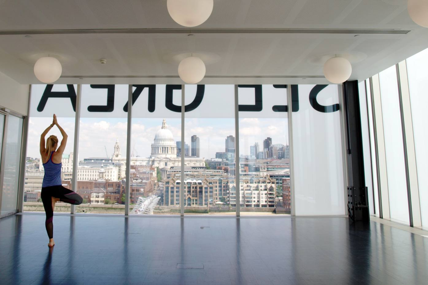 The yoga experience begins with classes, held in Tate Modern's East Room, which offers elevated vistas of London's cityscape