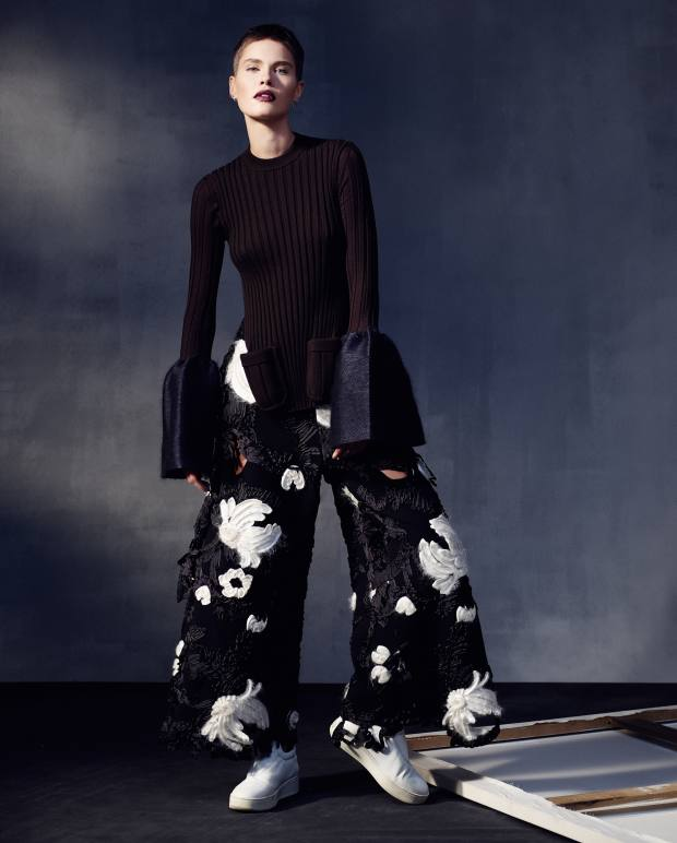 Kris wears Céline wool and felt jumper, about £1,270, embroidered wool Cornelly trousers, about £3,670, and lambskin shoes, about £508