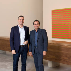 Massimiliano Gioni (left) and Tony Salamé at the Aïshti Foundation, Beirut, in front of two untitled works by Wade Guyton