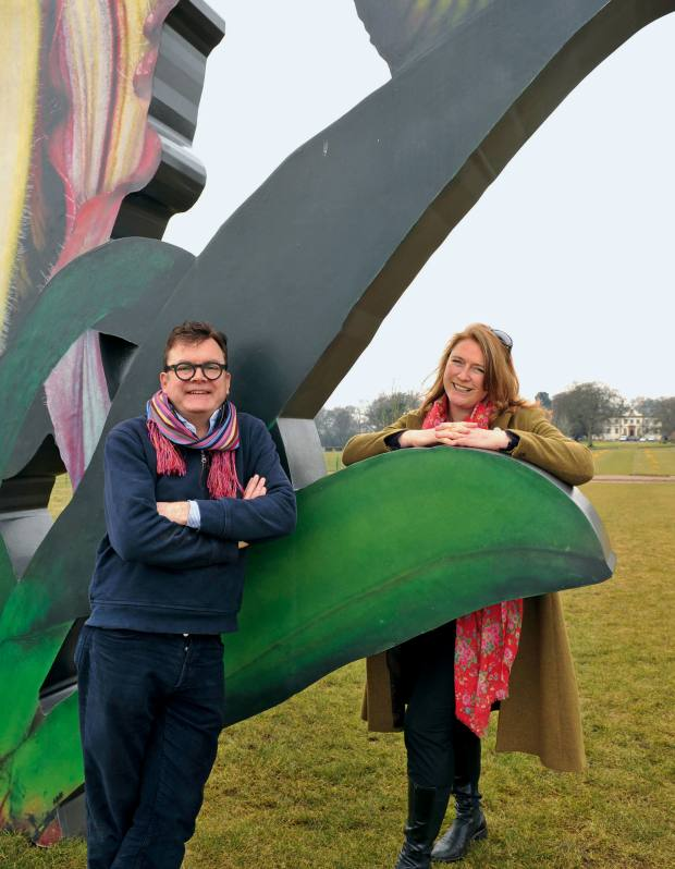 Jupiter Artland owners Robert and Nicky Wilson next to Marc Quinn's Love Bomb.