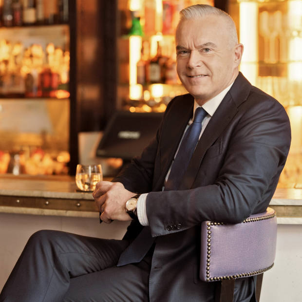 Huw Edwards wearing hisvintage Jaeger-LeCoultreMemovox in theArtesian bar at The Langhamhotel, London