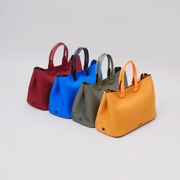 The bags have leather handles that have been immersed in dye, so it fully permeates and won't scratch or wear off