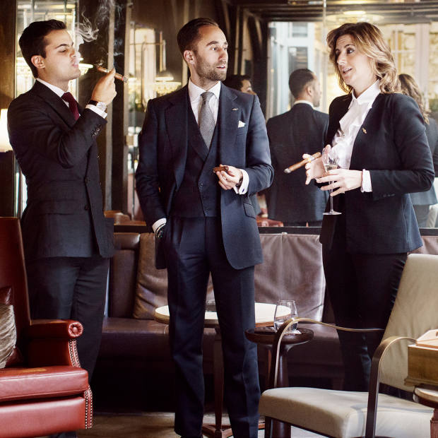 From far left: Manu Harit, head cigar sommelier of The Arts Club Group, Darius Namdar, cigar sommelier for the Birley Group, and Paola Paolillo, cigar lounge manager forTen Trinity Square, atThe Arts Club in Londonwith, bottom right, a Trinidad 40th anniversary humidor