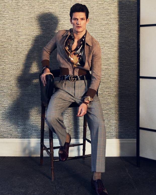 Gucci suede bomber, £2,690, silk shirt, £705, wool trousers, £615, embroidered leather lace-ups, £1,260, and crocodile belt, £805. Pantherella cotton Lisle socks, £12. IWC vintage hand-wound 18ct rose gold Portofino watch on alligator strap, £12,900