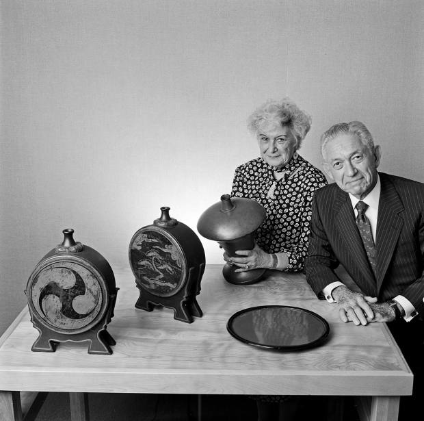 Florence and Herbert Irving with a selection of Japanese lacquer works from their collection