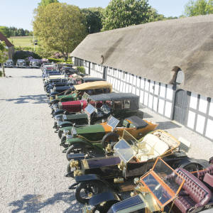 Prewar cars lined up at Lyngsbaekgaard, Henrik Frederiksen's 16th- century manor house