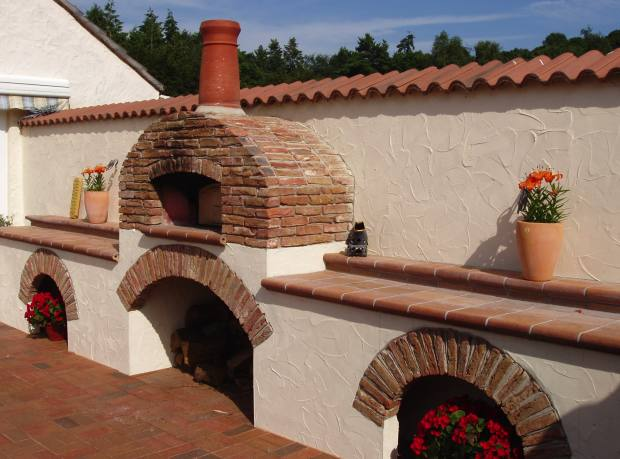 A top-of-the-range, custom-built Jamie Oliver Wood Fired Oven, about £12,500, installed in Kent.