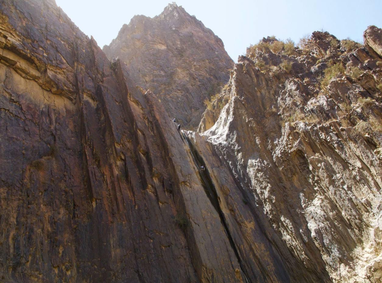 Abseiling down Wadi Al Feid's longest waterfall.