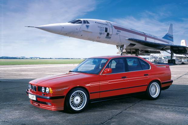 The B10 Bi-Turbo, launched in 1989, pictured next to a Concorde jet