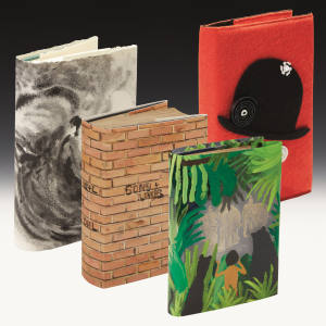 Four of the specially redesigned book covers for Sotheby's First Editions Re-covered sale on December 11