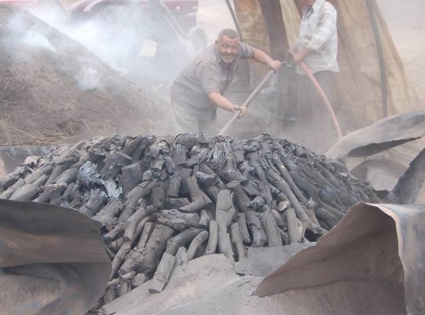 Hosing down the charcoal in the charcoal factory.
