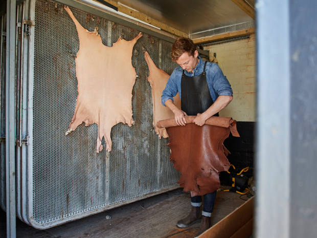 Billy Tannery co-founder Jack Millington with a self-tanned goat hide