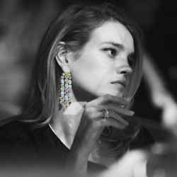 Model Natalia Vodianova wearing Star Diamond Private Jeweller fancy coloured and white diamond and platinum earrings