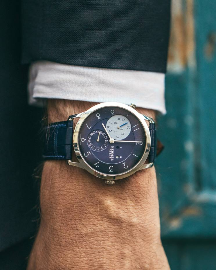 The limited edition Slim d'Hermès GMT Hodinkee design features a blue dial and watch strap. Only 24 will be made, priced $14,700