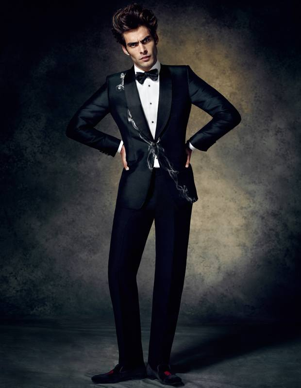 Alexander McQueen bespoke tuxedo with smoke-effect silk‑jacquard jacket and mohair trousers, £6,550, cotton-poplin shirt, £295, silk bow tie, £100, and velvet slippers with beading, £450** To bid for this suit in aid of Save the Children, visit Christies.com/HTSI. Online auction ends December 11. **