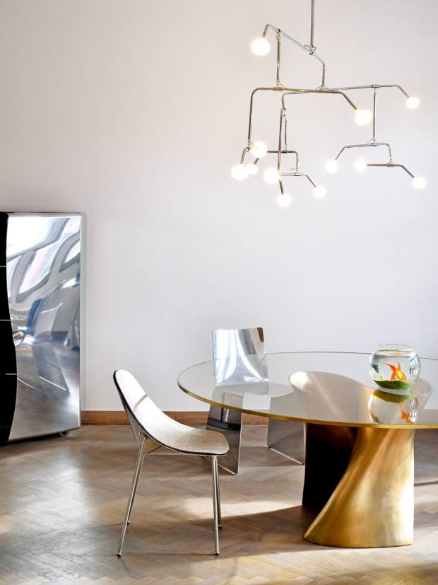 Xavier Lust aluminium Meuble d'Appui cabinet, edition of eight, $160,000; bronze and glass S table, edition of eight, $150,000; aluminium Cone (left of table) and T chairs, $5,000 and $3,200