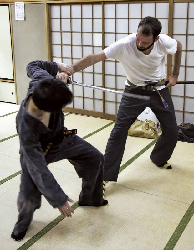 Learning strikes, joint locks and disarms at the Bujinkan dojo.