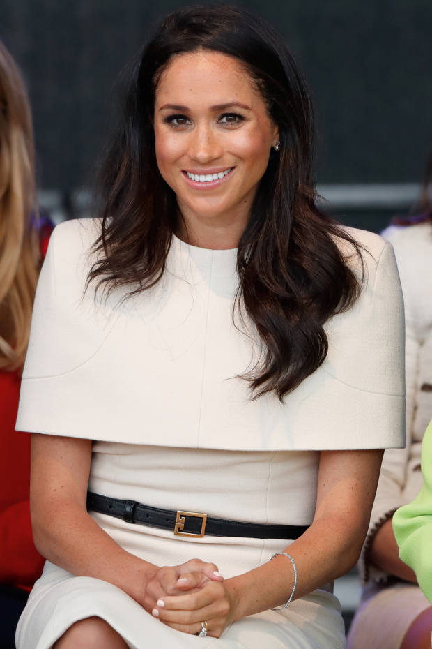 The Duchess of Sussex wearing Waight Keller's trademark cape dresses