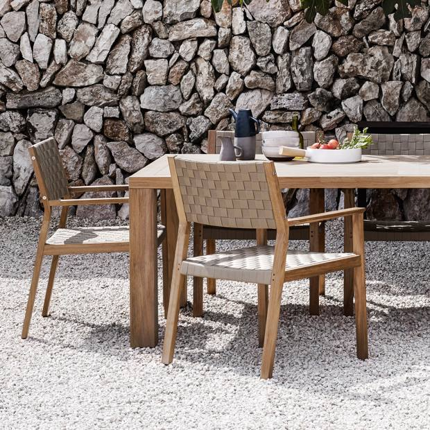 Gloster teak and polypropylene dining chairs, £511, and teak square dining table, £2,559