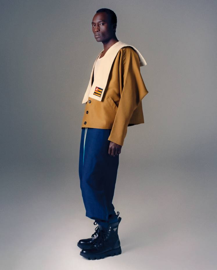 Lanvin silk/wool sailor jacket, £1,445, and wool/linen trousers, £665. Sunspel superfine cotton vest,£30, from matchesfashion.com. Prada leather/nylon Rocksand boots, £740