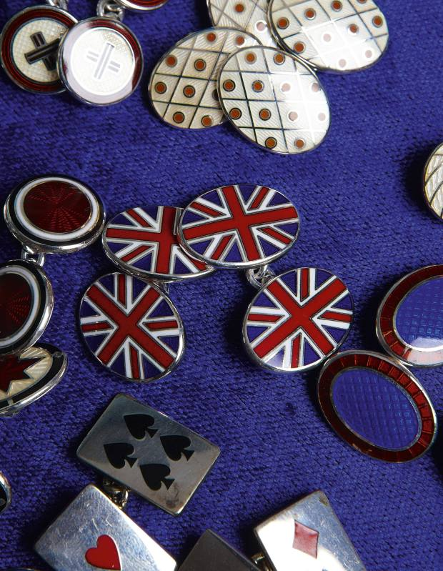 Silver and enamel cuff links, £160.