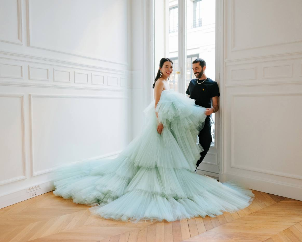 Wendy Yu with Giambattista Valli at his Paris studio, wearing a gown from the designer's most recent couture collection