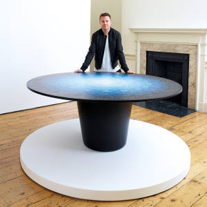 Artist Brodie Neill with his plastic and resin composite Gyro table, price on request, which was displayed in London Design Biennale's Australian Pavilion