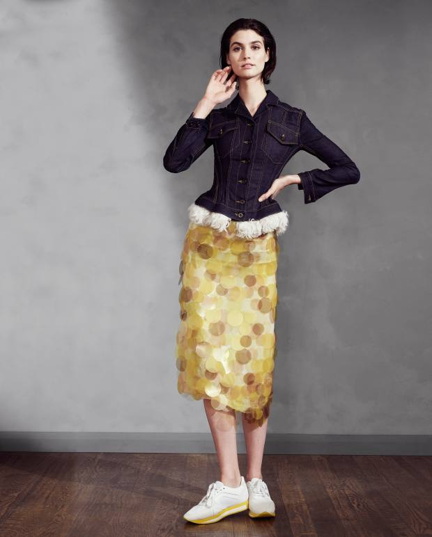 Deluxe denim Designers elevate the original workwear fabric with couture techniques such as corsetry  Burberry denim jacket with shearling trim, £1,795, silk‑organza pencil skirt embellished with sequins, £2,295, and leather and suede trainers, £395
