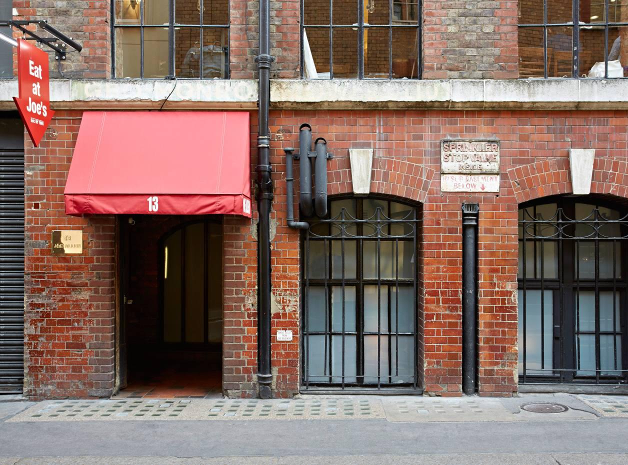 The entrance to legendary Covent Garden basement restaurant Joe Allen