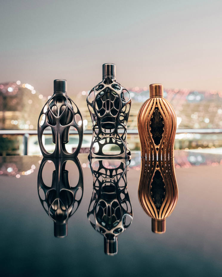 The five perfumes are housed in Ross Lovegrove's sculptural bottle designs (from left): Fluid Symmetry, Compact Sensation and Agile Embrace