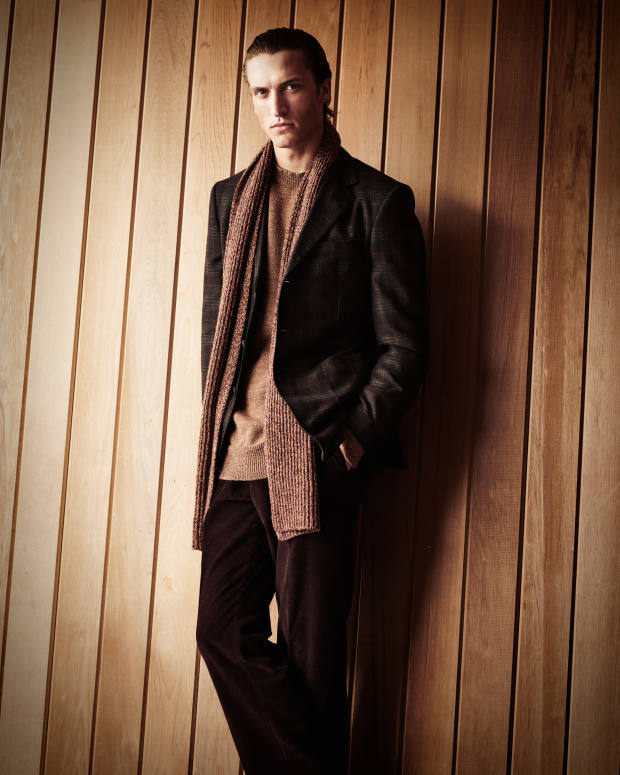 Gieves & Hawkes wool/cashmere jacket, £495, cotton-corduroy trousers, £225, and wool scarf, £195. MHL by Margaret Howell wool Utility jumper, £155