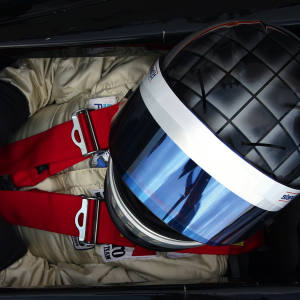 A driver squeezes into the cockpit of an F1 car at the AGS school.