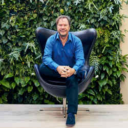John Hitchcox in one ofhisArne Jacobsen-designed Egg chairs