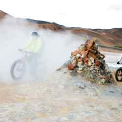 Ragnar Baldvinsson of Mývatn Activity leads the way through smoke at the bubbling mudpools of Hverir