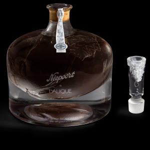 Bids for this Lalique demijohn decanter, which is filled with a 155-year-old vintage, will start at $20,000