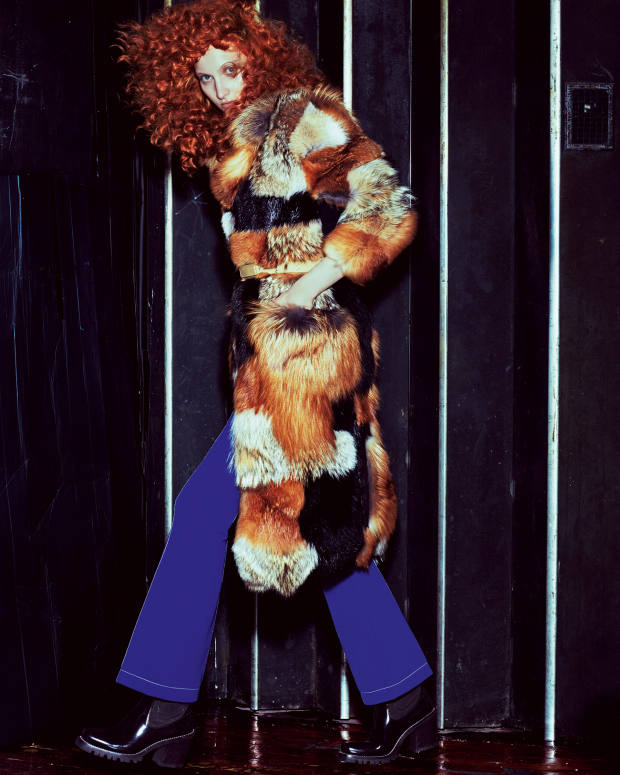 Louis Vuitton fox-fur coat withsuede belt, £17,950, poly/silk trousers, £850, and leather ankle boots, £1,000