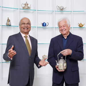 Nirmal Sethia (left) and Kevin Page, holding a teapot from a c1880 Japanese Tomoyuki tea set