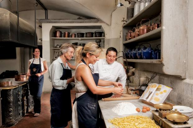 Guests at a cookery class at Villa Le Corti, in the Corsini family vineyard in Chianti Classico, Tuscany