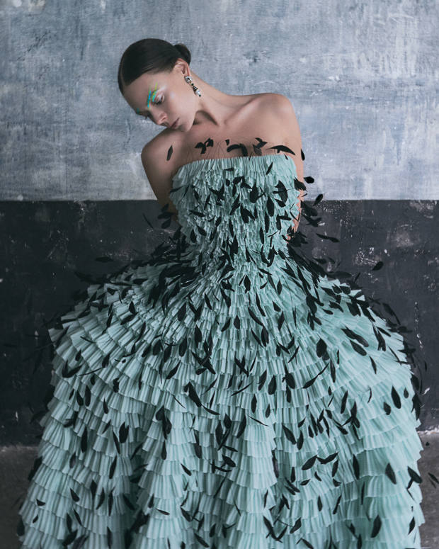 Givenchy Haute Couture silk organza and feather Chaumont dress, POA. Van Cleef & Arpels white and yellow gold, diamond, emerald, sapphire, black spinel and pearl Balletti earrings, POA