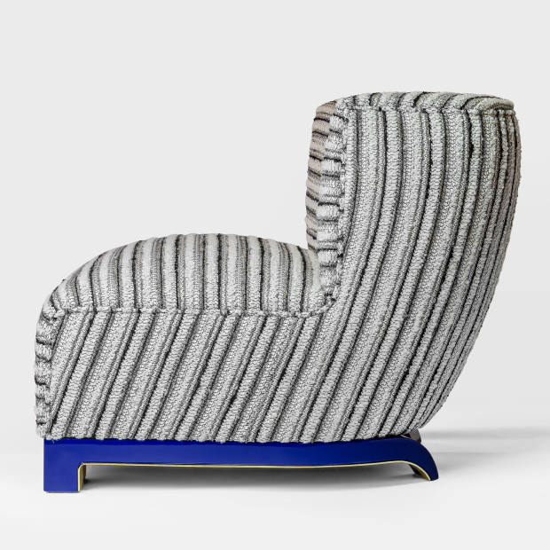 2013 Vittoria armchair, upholstered in velvet with lacquered wood and brass details, €26,400