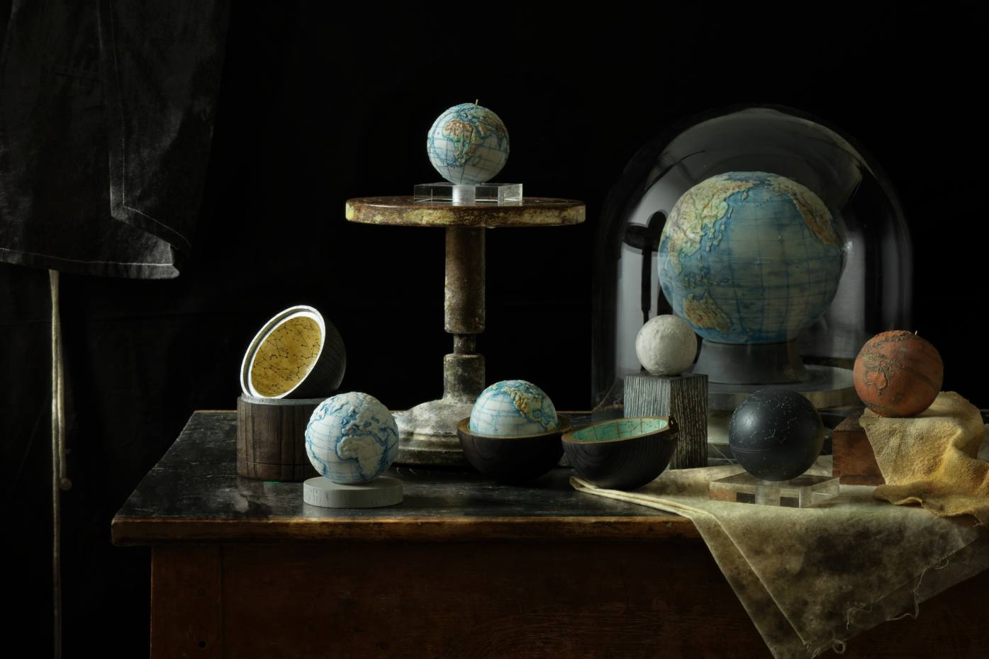 Rutt decorates her globes using ceramic stains and metal oxides