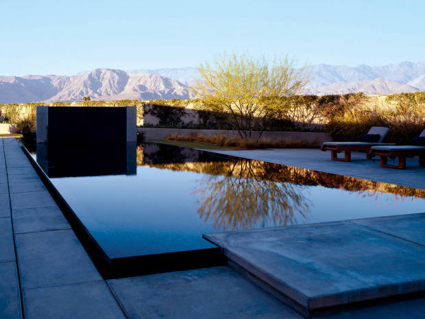 The reflective pool at Olson Kundig's Desert House in California mirrors its surroundings