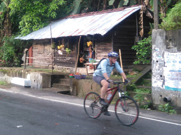 The author passes stalls bythe roadside en route to the climb