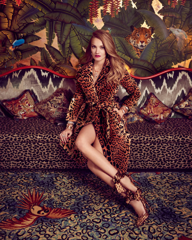 Victoria Beckham chenille jacquard coat, £2,495. Christian Louboutin silk and Lurex Panthère Drama Douce heels, £795. Bulgari rose gold, diamond, mandarin garnet, peridot, pink tourmaline and citrine earrings, rose gold, diamond and emerald Serpenti necklace; right arm: white gold and diamond Serpenti Two‑Coil bracelet, rose gold and diamond Serpenti Tubas bracelet, rose gold and diamond Parentesi bracelet, and white gold, diamond, sapphire and aquamarine Serpenti ring; left arm: rose gold, diamond and turquoise Serpenti secret watch, and rose gold, diamond and coral Serpenti secret watch; all price on request, and python Serpenti Forever bag, £2,950